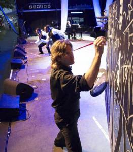 "While Three Mo' Tenors performed  while Canadian artist Eric Waugh drew the tenors ""live on stage"".  The painting was later auctioned with proceeds going to charity."