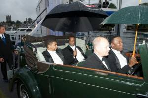 On the way to the stage in a vintage antique at the Henley Festival, a light drizzle begins...  L to R:  Victor Robertson, Phumzile Sojola, Ramone Diggs.